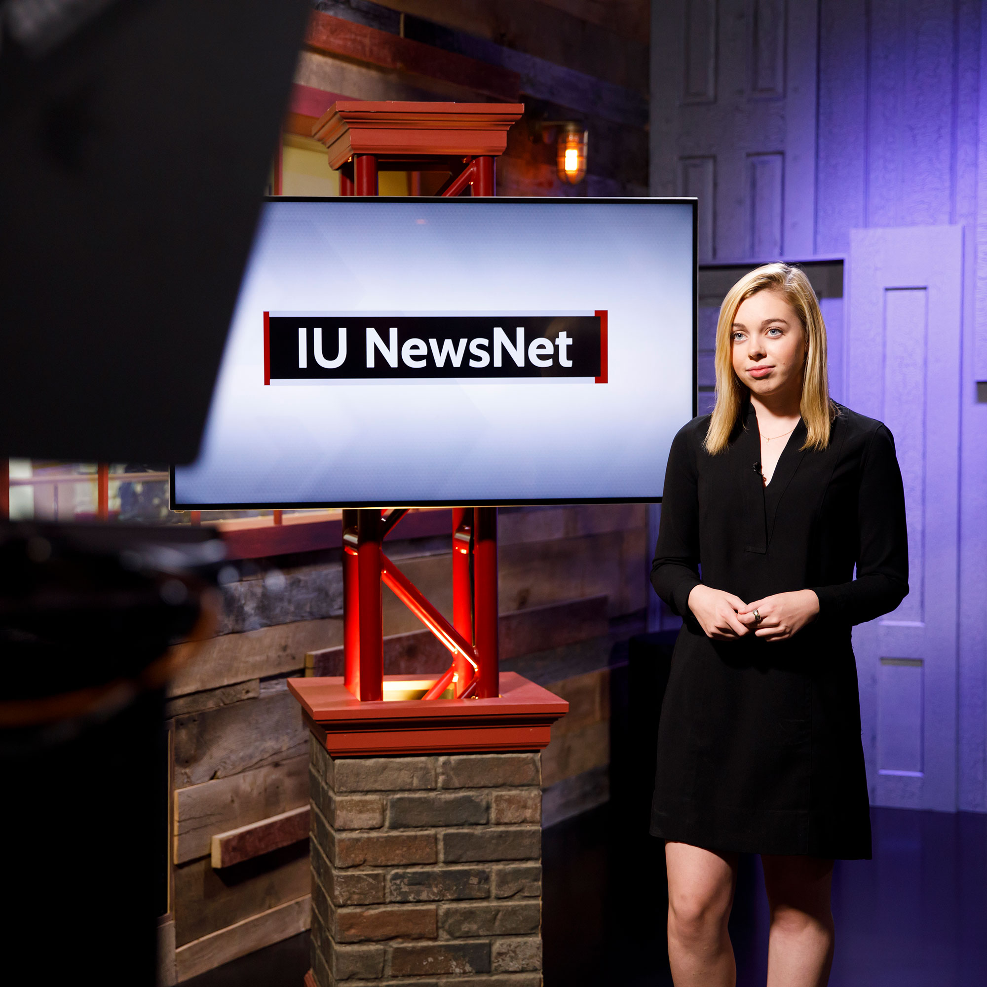"Mary Kate Hamilton in front of a screen that says ""IU NewsNet"""