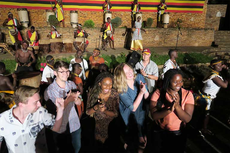 Students attend a traditional African event.
