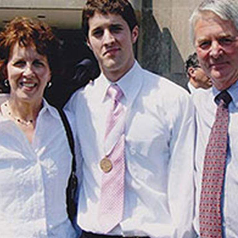 Matthew Luedeman, center, with his family, died in 2011 of a brain tumor. His family set up a scholarship in his memory.